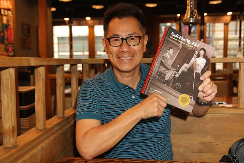 Arthur Dong shows off the new hardcover edition of Forbidden City, USA: Chinatown Nightclubs, 1936-1970. Photo by Lia Chang