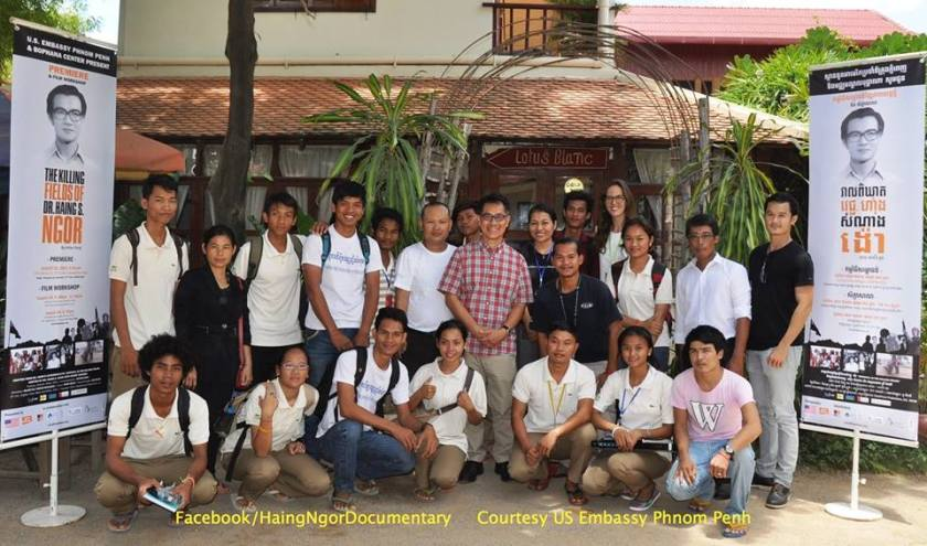 """Director Arthur Dong (center) screened The Killing Fields of Dr. Haing S. Ngor and coached film students at Pour un Sourire d'Enfant - Cambodia. PSE educates and houses disadvantaged kids from the dump-site in Stung Meanchey, Phnom Penh. Media production is one of their vocational training programs; it's a three year program and the only """"film school"""" in Cambodia. Facebook/HaingNgorDocumentary Photo courtesy of US Embassy Phnom Penh"""