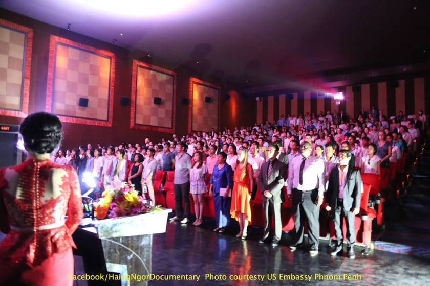 """Salute to the national anthem, at the Cambodia premiere, """"The Killing Fields of Dr. Haing S. Ngor,"""" August 21, 2015, Major Cineplex Phnom Penh. Facebook/HaingNgorDocumentary Photo courtesy of US Embassy Phnom Penh"""