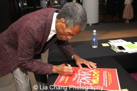 André De Shields signs the 'Gotta Dance' poster at the 27th Annual Awards for Excellence in the Arts Gala held in the Atlantic Ballroom of the Radisson Blue Aqua Hotel in Chicago on November 9, 2015. Photo by Lia Chang