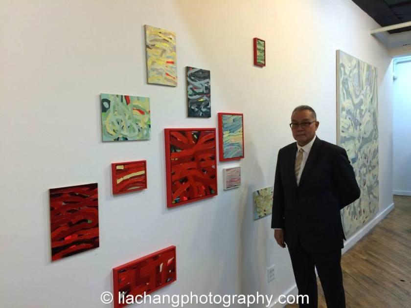 """Arlan Huang at the opening reception of """"Swimming Awkward Moment"""" at the Trestle Gallery in Brooklyn. Photo by Lia Chang"""
