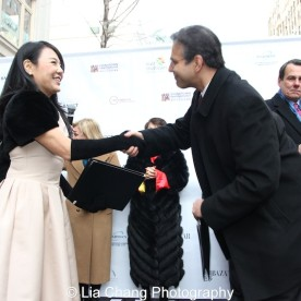 """Chair of the Bund Association for Promotion of Commerce & Trade, Michelle Lee and Matthew Bauer, President, Madison Avenue BID, at """"Madison Street to Madison Avenue"""" Lunar New Year Celebration on Feb. 6, 2016 in New York City. Photo by Lia Chang"""