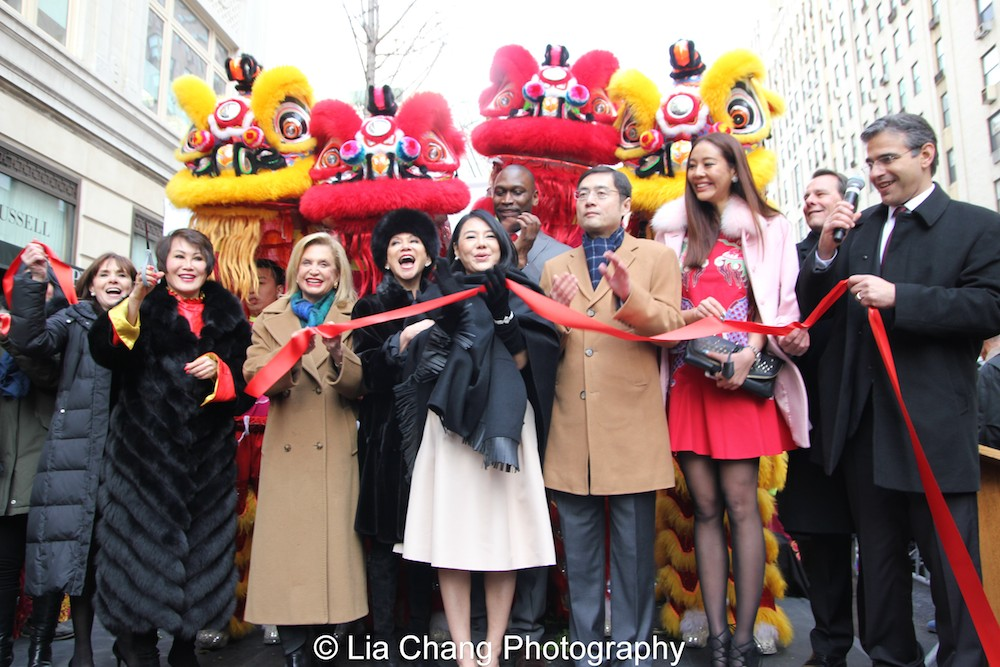"A ribbon cutting is held to celebrate the partnership between Madison Avenue BID and the Shanghai Bund Association at ""Madison Street to Madison Avenue"" Lunar New Year Celebration on Feb. 6, 2016 in New York City. Photo by Lia Chang"