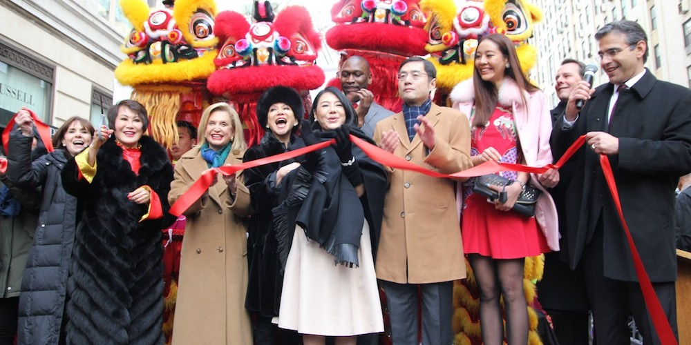 """A ribbon cutting is held to celebrate the partnership between Madison Avenue BID and the Shanghai Bund Association at """"Madison Street to Madison Avenue"""" Lunar New Year Celebration on Feb. 6, 2016 in New York City. Photo by Lia Chang"""