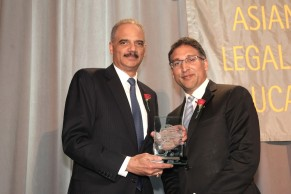 Eric H. Holder, Jr., former Attorney General of the United States and partner at Covington & Burling LLP, was presented the 2016 Justice in Action Award by Former Justice in Action honoree Neal Katyal, Partner at Hogan Lovells and former Acting Solicitor General of the United States at the AALDEF lunar new year gala at PIER SIXTY, Chelsea Piers in New York City on February 16, 2016. Photo by Lia Chang