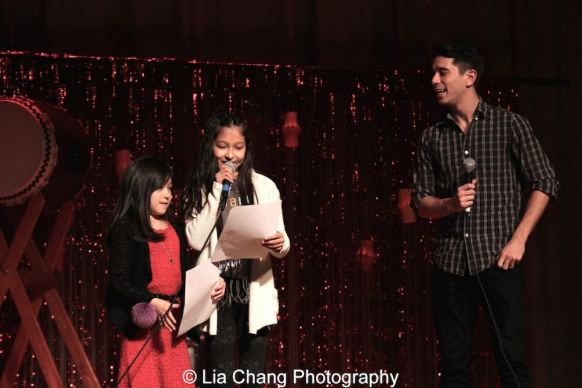 Lainie Sakakura and Alex Sanchez's daughters Isabela Sanchez (3rd grade), Avelina Sanchez (6th grade) and Sam Tanabe at the P.S. 87 Pan Asian Lunar New Year Celebration at the William T Sherman School in New York on January 29, 2016. Photo by Lia Chang