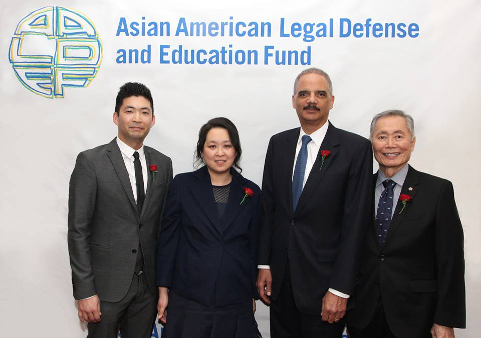 2016 Justice in Action Award recipients Phil Yu, founder and editor of Angry Asian Man, Heidi C. Chen, Executive Vice President and General Counsel of Zoetis, Eric H. Holder, Jr., former Attorney General of the United States and partner at Covington & Burling LLP with actor and activist George Takei, a 1992 Justice in Action Award recipient at the AALDEF lunar new year gala at PIER SIXTY, Chelsea Piers in New York City on February 16, 2016. Photo by Lia Chang