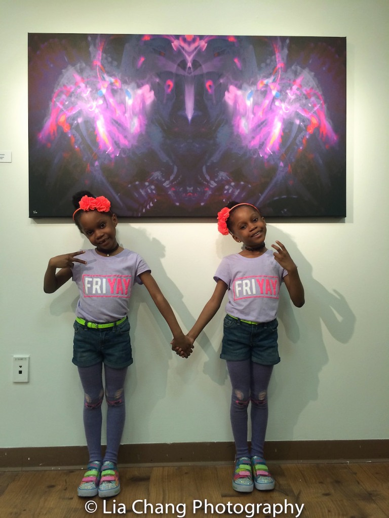 "Twins pose with ""Worlds Unseen"" by Will Calhoun, 2013 (60"" x 33"") at Will Calhoun's AZA Exhibit at Casita Maria Gallery in New York on April 22, 2016. Photo by Lia Chang"