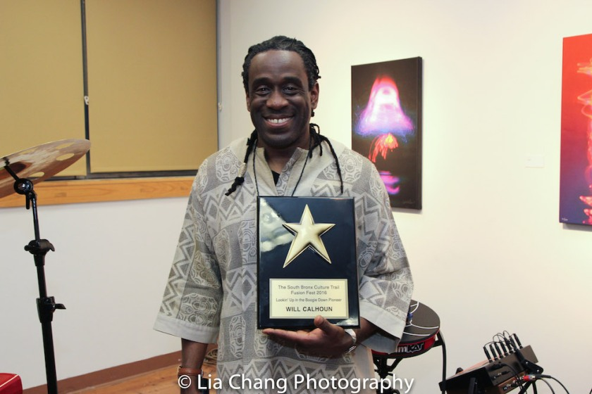 Will Calhoun receives the The South Bronx Culture Trail Fusion Fest 2016 Lookin' Up in the Boogie Down Pioneer Award at the opening reception of his AZA Exhibit at Casita Maria Gallery in New York on April 22, 2016. Photo by Lia Chang