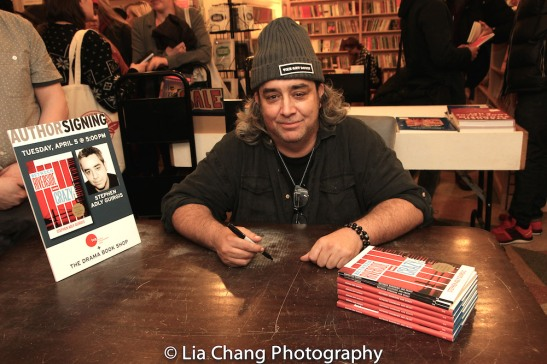 Pulitzer prize-winning playwright Stephen Adly Guirgis signing copies of his plays at the Drama Book Shop in New York on April 5, 2016. Photo by Lia Chang