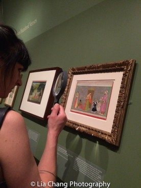 """Magnifying glasses are provided for viewing the miniature paintings in """"Divine Pleasure"""". Photo by Lia Chang"""