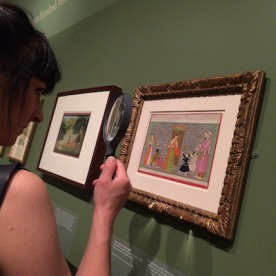 "Magnifying glasses are provided for viewing the miniature paintings in ""Divine Pleasure"". Photo by Lia Chang"