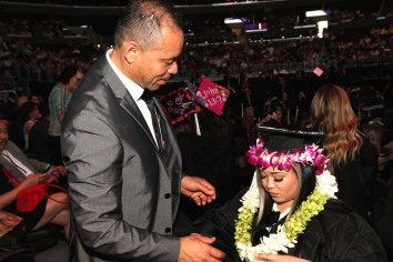 Carlos Flores and his daughter Asia Flores at the 2016 FIDM Graduation at the Staples Center in LA on June 20, 2016. Photo by Lia Chang