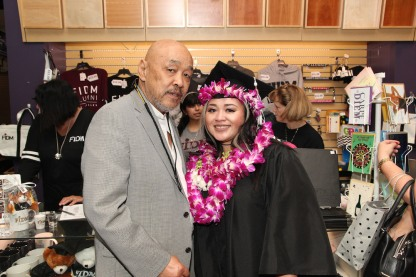 Russell Chang with his granddaughter Asia Flores at the 2016 FIDM Graduation at the Staples Center in LA on June 20, 2016. Photo by Lia Chang