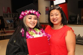 Asia Flores with her mother, Marissa Chang-Flores at the 2016 FIDM Graduation at the Staples Center in LA on June 20, 2016. Photo by Lia Chang