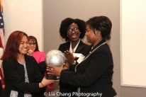 "JFEW Scholars Karina Santosa and Stella Oduro present a gift to Mathilde Mukantabana, Ambassador of the Republic of Rwanda to the United States of America at the ""Celebrate Rwanda"" event at The SUNY Global Center in New York on June 29, 2016. Photo by Lia Chang"
