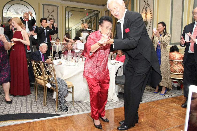 Mrs. Koo dances with her son-in-law Oscar Tang at her 111th birthday party at The Pierre in New York on October 2, 2016. Photo by Lia Chang