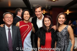Jin Ha introduces his family to Clive Owen. Photo by Lia Chang