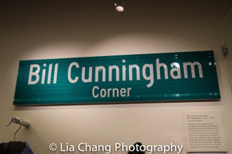 "The official street sign for ""Bill Cunningham Corner."" The sign was temporarily installed by Mayor Bill de Blasio at Fifth Avenue and 57th Street, Cunningham's favorite haunt for spotting street style, in the artist's honor following his death. Photo by Lia Chang"
