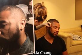 Putting scar makeup on: Jaclyn Vela and Blake Morris. Photo by Lia Chang