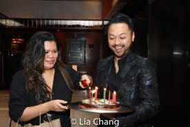 Liz Casasola and Billy Bustamante deliver a birthday surprise for music director Kimberly Grigsby. Photo by Lia Chang